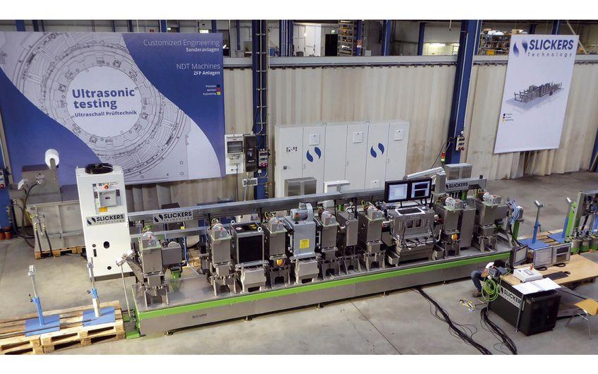 Slickers Technology: Slickers Technology: Ultraschall-Prüfanlagen für Rohre und Rundstähle