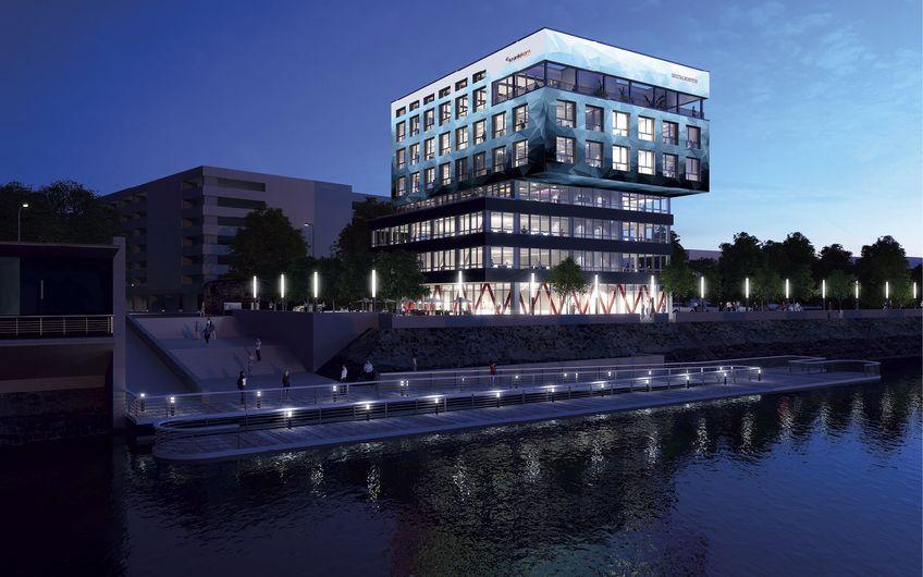 Der Neubau für die Duisburger Krankikom GmbH passt sich perfekt in die bestehende Bebauung ein und wird seiner Funktion als Bürokomplex ebenso gerecht wie dem starken Öffentlichkeitscharakter des Innenhafens (Quelle: KZA)